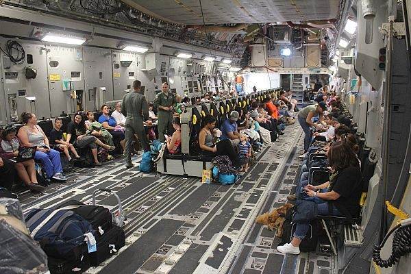 "NAVAL STATION GUANTANAMO BAY, Cuba (Oct. 2, 2016) Families settle into their seats aboard a Boeing C-17A Globemaster III aircraft for evacuation from Naval Station Guantanamo Bay (NSGB) ahead of Hurricane Matthew. Approximately 700 spouses and children were evacuated to Naval Air Station Pensacola, Fla. NSGB tenant commands continue to make preparations for Matthew. Hurricane Condition of Readiness 2 (COR II) was set base-wide in preparation for destructive winds within 24 hours. Base residents were reminded on the importance of being prepared with essential supplies and were advised to remain within their residence until the ""all clear"" was passed. (U.S. Navy photo courtesy of Army Capt. Frederick H. Agee/Released)"