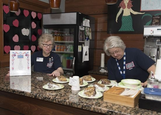 Josie Donithan and Kathy Spanarelli, USO Delaware volunteers, maintain all amenities that are available for service members and their families at the USO Delaware center Feb. 21, 2017, at Dover Air Force Base, Del. The mission of the USO is to strengthen America's military service members by keeping them connected to family, home and country, throughout their service to the nation. (U.S. Air Force photo by Senior Airman Zachary Cacicia)