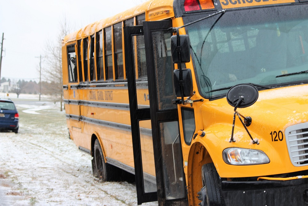 2 killed in crash between school bus, vehicle near Wounded Knee